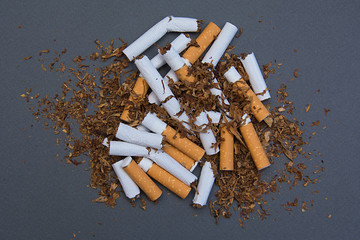 Stop smoking. Cigarettes cause cancer and kill. Gray background.