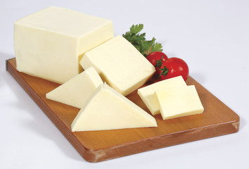 cheese on wooden board isolated on white