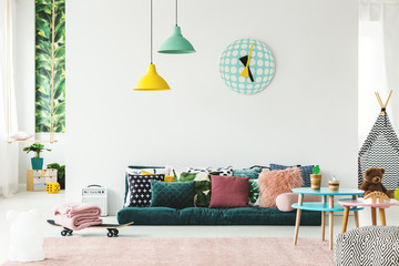 Colorful playroom with sofa