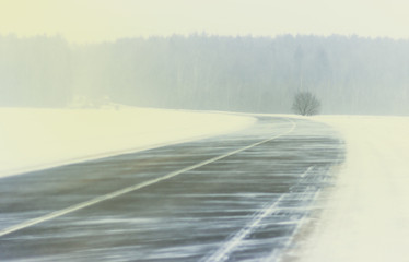 Winter. Blizzard snowstorm winter road of a snowy landscape. On the road there are no car