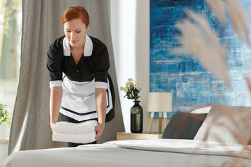 Chambermaid in the hotel's room