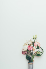 beautiful elegant bouquet of white and pink flowers in vase isolated on grey