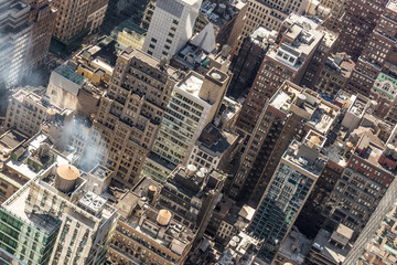Fototapete - New York City, USA. Midtown Manhattan building rooftops with steam comming from the heating systems.