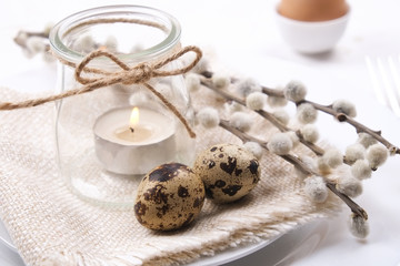 Easter laying table appointments, table setting options. Tableware items with festive decoration and flowers. Happy easter holiday.