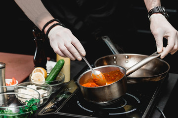 hands of chef making healthy fresh fajitas or fajitos with beef. Easy, but tasty, healthy. National Mexican food, fresh oganic food.