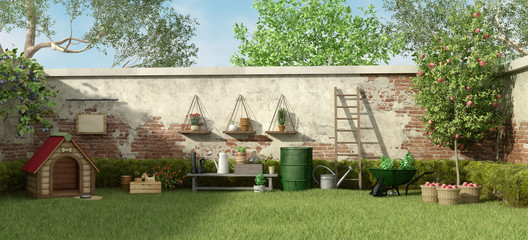 Garden with dog house and gardening tools