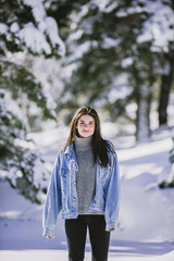 A beautiful woman in the snow