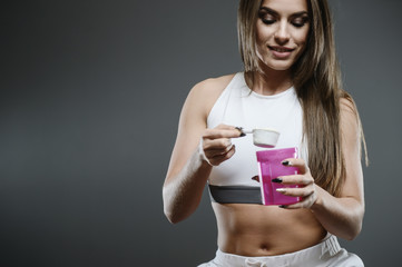 girl with supplement whey protein shake powder