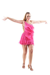 Happy smiling professional dancer in pink costume with outstretched arms pose. Full body length portrait isolated on white studio background.