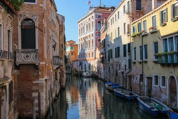 Narrow water street of historic center of Venice, Italy
