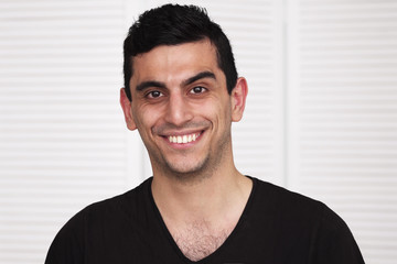 Young happy middle eastern man smiling