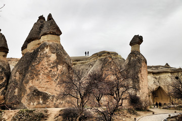 Tourists are visiting historical priest caves in Pasabaglari Valley, Cappadocia