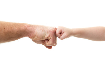 Funny fight. Father's and his son's knuckles. Dad's and kid's hands over white. Male and children hands closep, isolated on white background. Violence in family.
