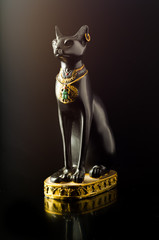 Statue of the Egyptian black Bastet cat with reflection