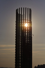 Steel reinforcement as part of a reinforced concrete structure shines through the sun