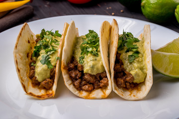 Mexican tacos with beef and guacamole