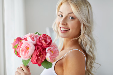 close up of woman with bunch of flowers
