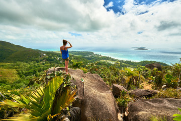 Adventure woman hiking on chenard mountain, praslin, seychelles