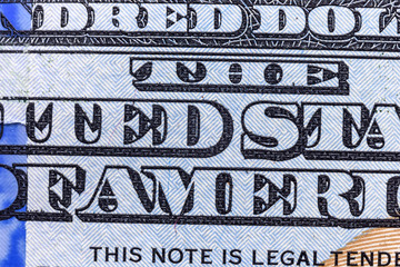 a fragment of a banknote one hundred American dollars