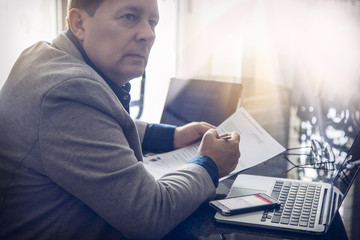 Businessman working with documents at the office table, horizontal