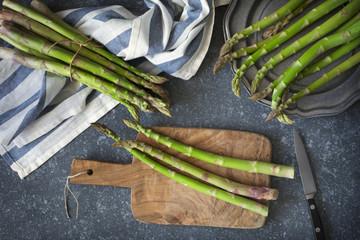 Fresh  raw asparagus on stone background
