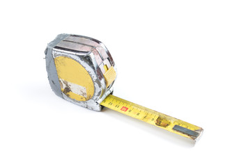 Old and worn out yellow measure tape on a white background, surface. Industrial measure tape.