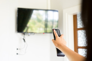 Hand using with TV remote control on-off mode