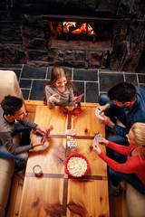 top view of Happy family having fun and playing cards