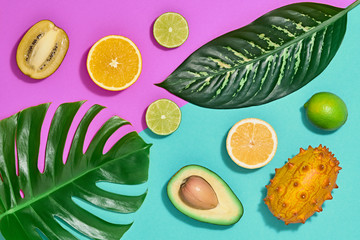 Tropical Colorful Summer Design Set. Palm Leaves and Fresh Fruits. Vegan Trendy Fashion concept. Flat lay. Creative Bright summer background. Minimal