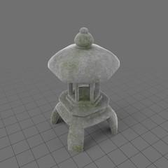 Short, stone garden lantern