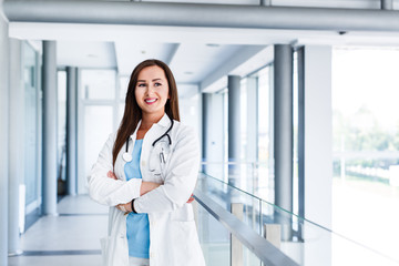 Beautiful young female doctor posing at hospital