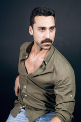 Young handsome man with beard and mustache studio portrait