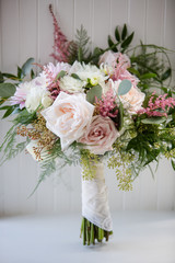 Pink and White Floral Wedding Bouquet with Roses and a Handkerchief in Window