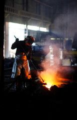 A man works at a smelter in metal factory Dema, in Buenos Aires