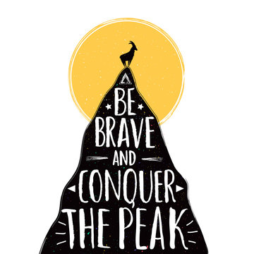 Vector illustration with goat silhouette on the top of the mountain peak. Be brave and conquer the peak lettering quote.