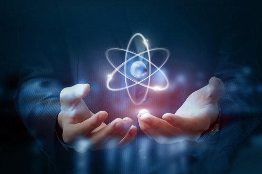 Hands shows the atom .