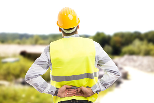 Injured construction worker or engineer suffering backpain.