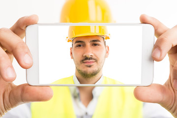 Constructor or builder taking a selfie with smartphone.