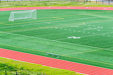 Detail of a Soccer Field with a Net and a Running Track around it