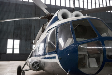 Two-turbine helicopter in the hangar.