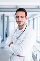 Happy smiling cheerful male doctor