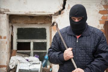 A thief with a crowbar