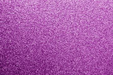 Glittering background in purple color.