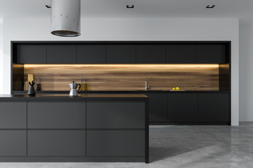 Front view of a black and wooden kitchen