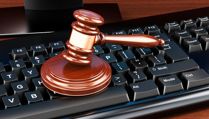 Computer keyboard with wooden gavel. 3D rendering