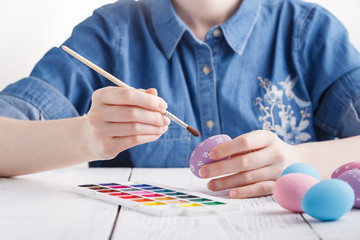 Female hands painting Easter eggs