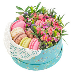 Macaroons in gift box with flowers isolated