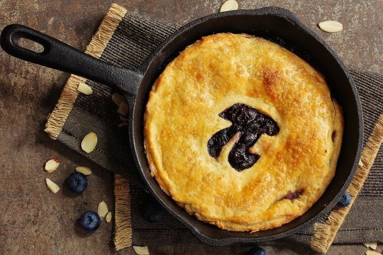 Pi Day special homemade blueberry pie baked in a skillet overhead view
