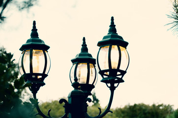 Street lamp at night shows light in the city.  Illumination with vintage feel.