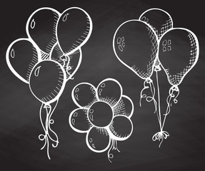 Group of balloons on a string. Hand drawn chalk on the board.